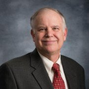 Picture of John Bobrowich for his bio, wearing a red tie.